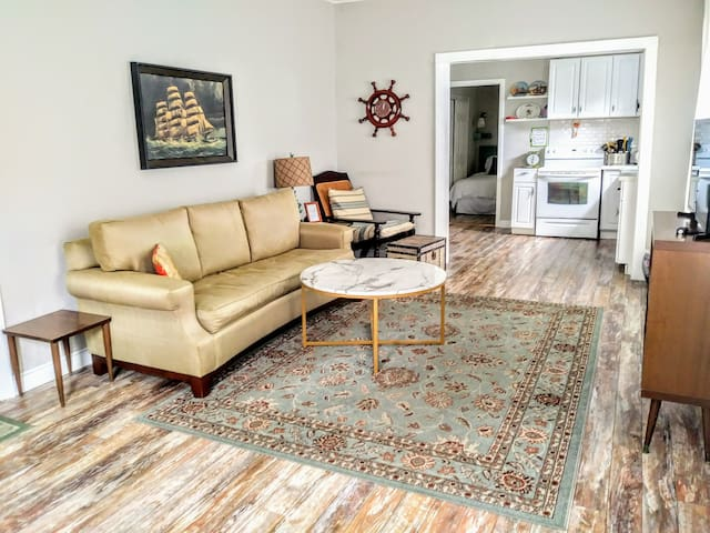 Open concept living room and kitchen. 2nd bedroom with 2 twin beds off kitchen.