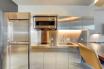 Kitchenette includes microwave, stovetop, fridge, dishwasher, pots,pans, silverware, glassware and more!