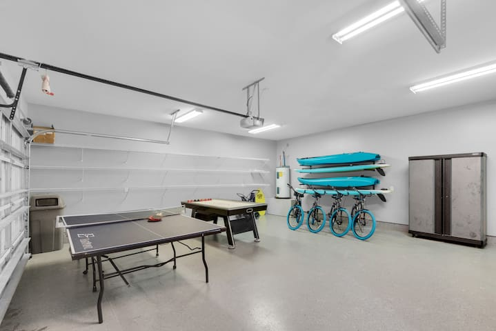 If you'd prefer to garage your vehicles, simply slide the ping pong and air hockey  tables to the side.  However, Mojo's massive driveway (by Destin norms) accommodates 8 cars.  So why not use the garage as a game room instead?