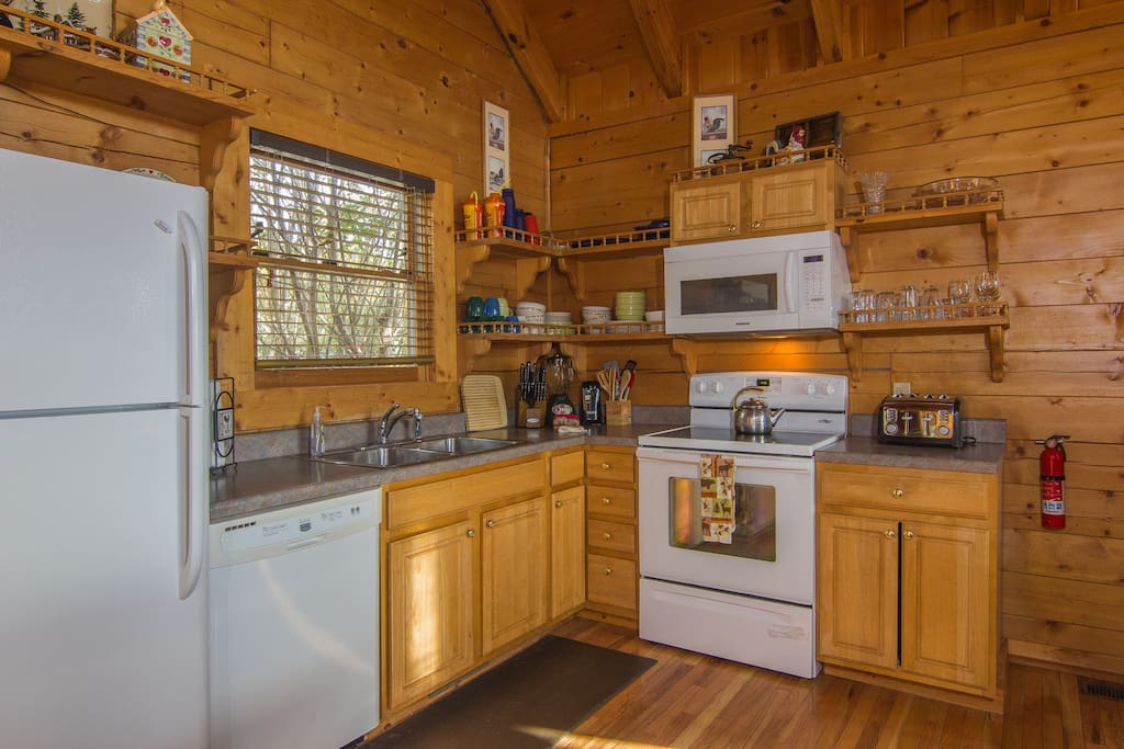 Fully equipped kitchen with basic appliances to prepare breakfast, lunch and dinner. We also have a Belgian waffle maker and slow cooker.