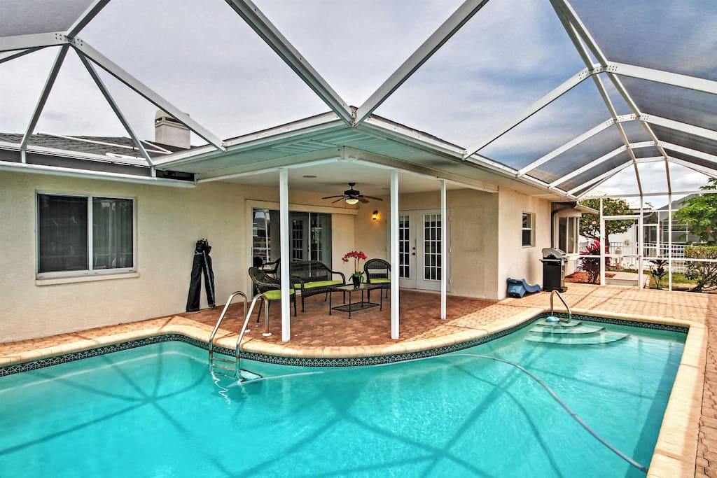 You'll love sunning by the sparkling private screened-in pool