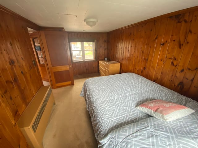 Master bedroom looking from the head of the bed. This is a queen bed. Please bring your own pillows, bedding and blankets, they are not included.