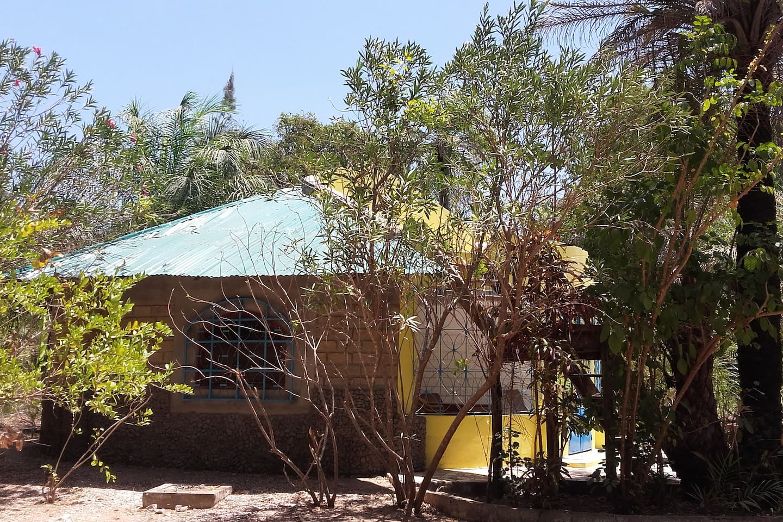 """Tenkuroto""  - Haus unter den Palmen"