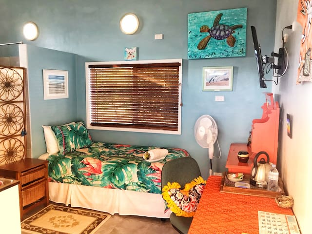 Tropical interior with fresh cotton sheets and a comfortable bed. Wall mounted TV for relaxed viewing.