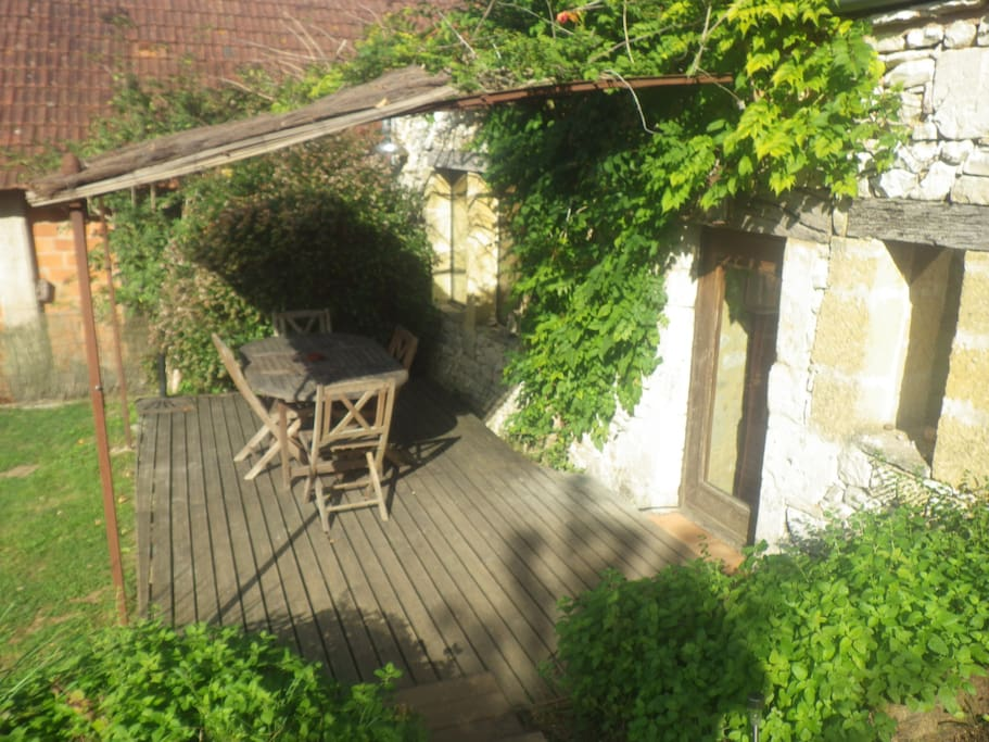 The wooden terrace: access via the back door - perfect for yoga practice, sunset gazing & long summer dinners.