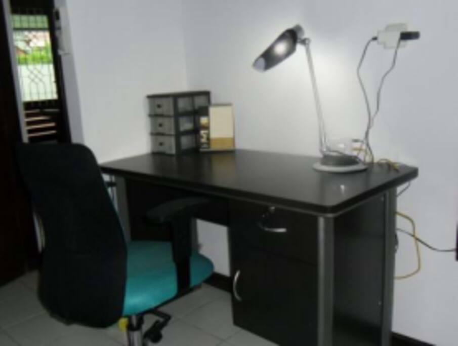 Full-sized work desk. Free internet.