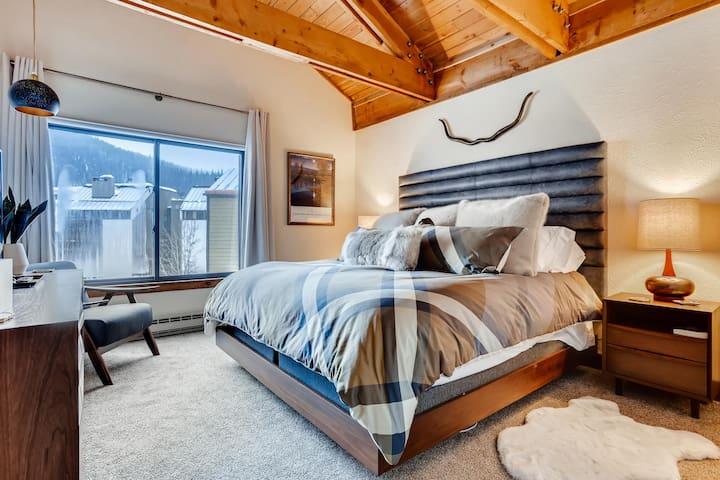 Upstairs master bedroom with flatscreen TV and dedicated bathroom.