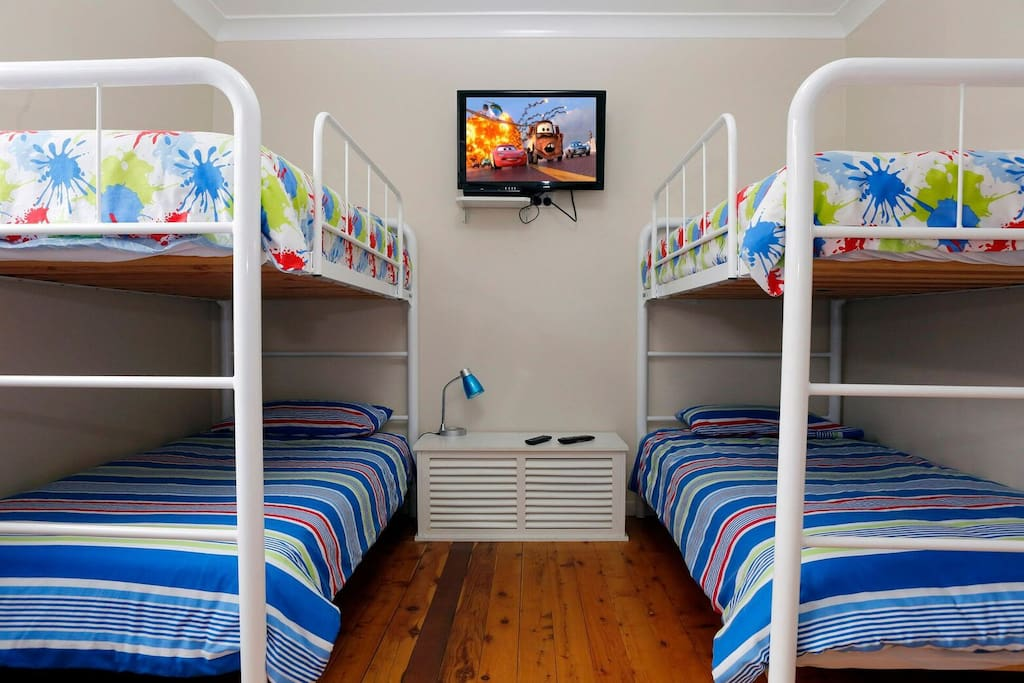Bedroom 3... Kids room 2 sets of bunk beds + lounge to chill and watch TV.