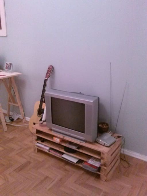 TV room with cable TV, DVDs, CDs and guitar on hand to make a sound!