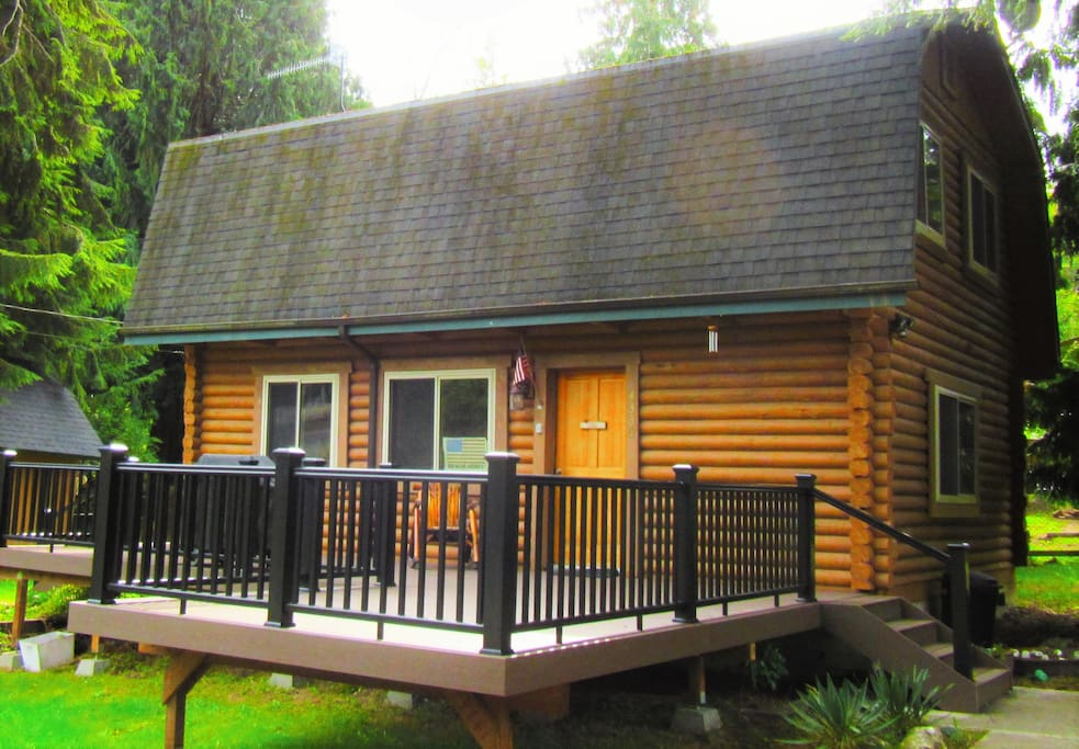 Cabin has large Trex deck with grill and, in summer, outdoor log furniture.