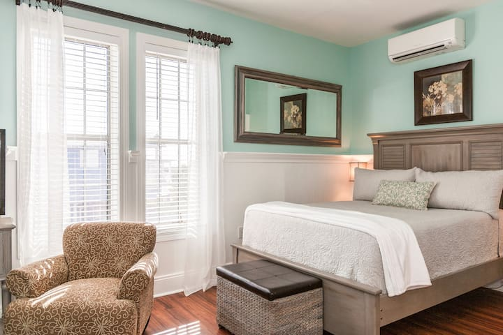The bed is made with hotel-quality linens by TurnKey's professional housekeeping team.