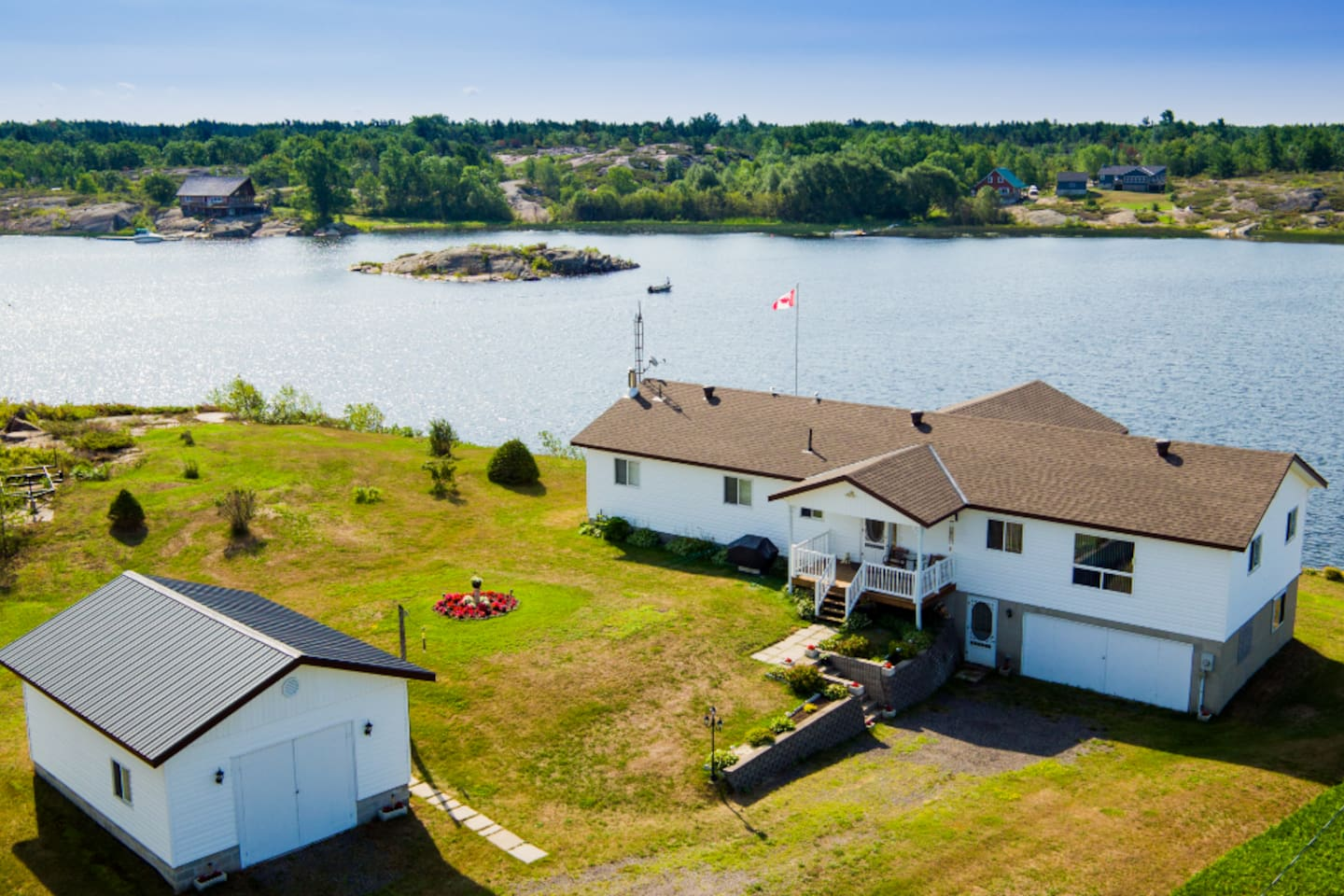 Magnificent view of the Magnetawan River.  Large sloped lot with steps down to the dock.