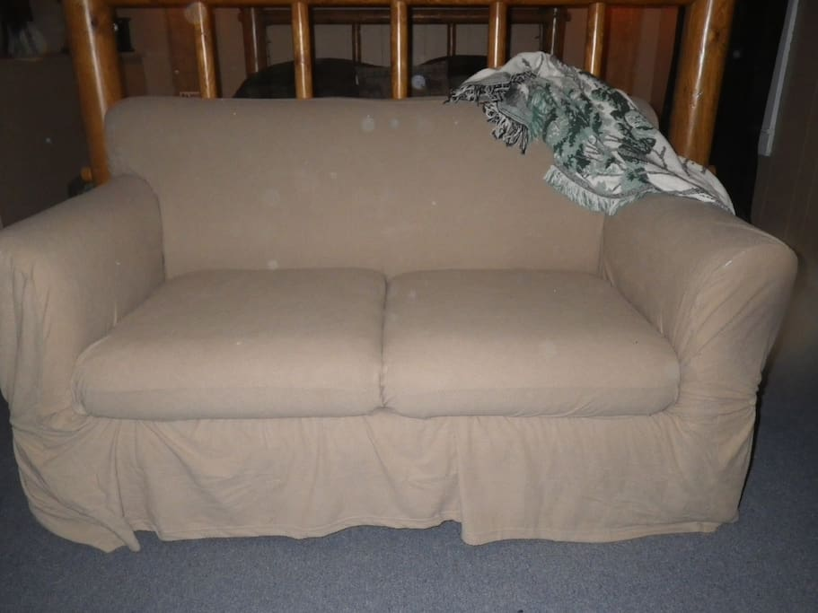 love seat in room for cuddiling while watching TV