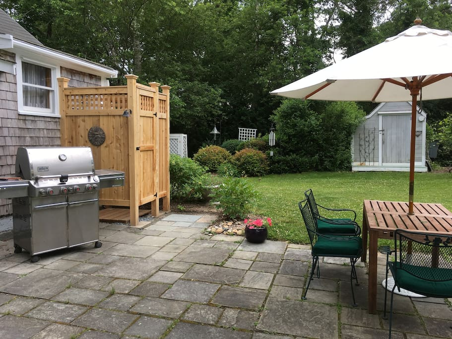 Patio with grill and outdoor shower