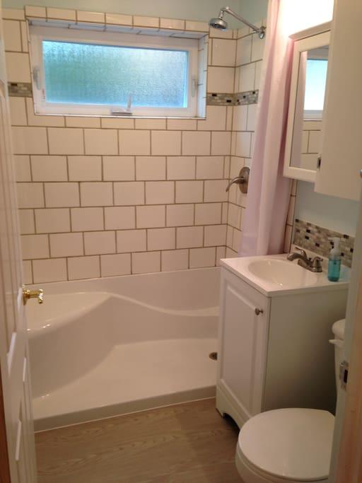 Bath 1, adjacent to Bedroom 1 (but not en suite)