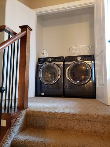 Washer and dryer at top of stairs. 3rd room locked upstairs, not for use (carpet and renting not my favourite... ha!!!)
