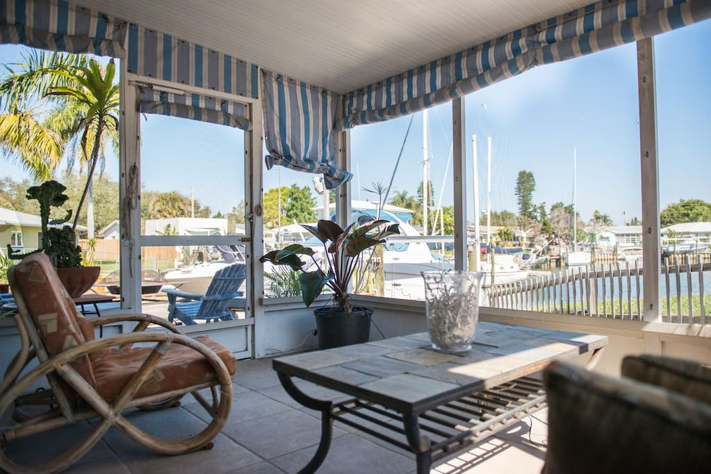 Screened in patio off of the lanai, with a great water view.  There is a multi-slide 3-panel door between the lanai and this room. Open it wide open to let the outdoors in.