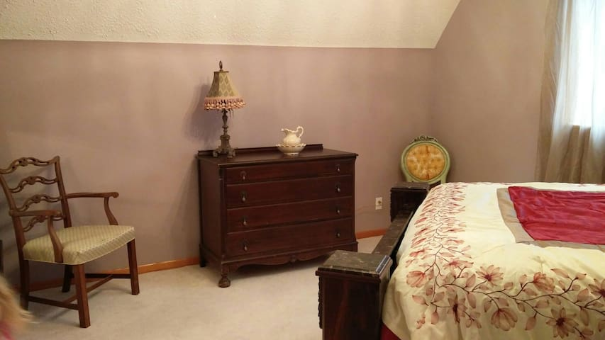 Antique dresser in master bedroom for your personal belongings to make it feel more like home.