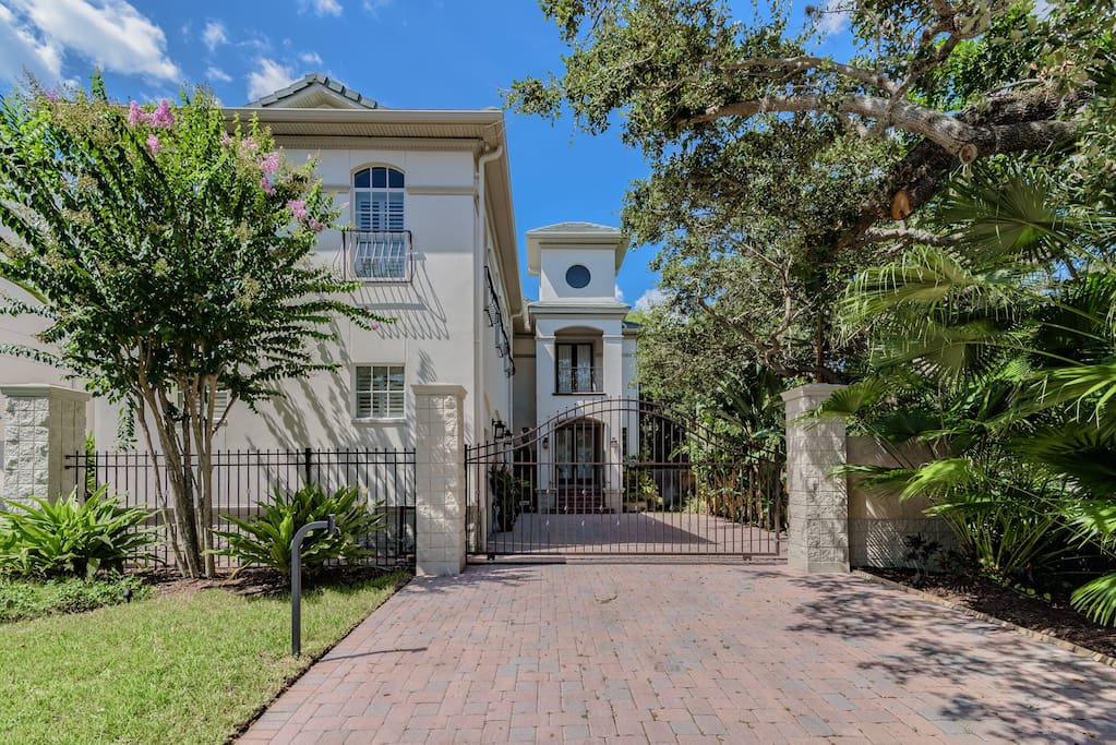 Gated Courtyard with 3 Car Garage and Covered Entry