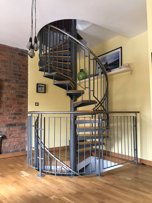 Open plan staircase connecting all 3 floors... Kitchen, leading up to Lounge and upwards to Bedroom & Bathroom