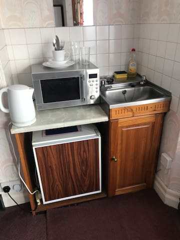 Private kitchenette with microwave, fridge, kettle and sink