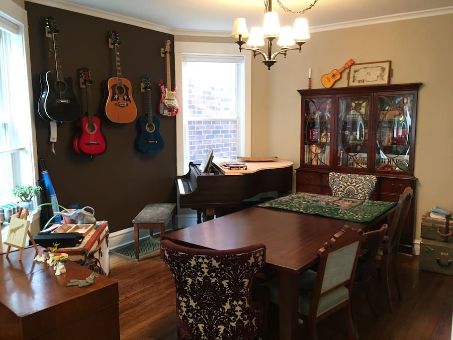The music room- now with baby grand piano and dining room table.