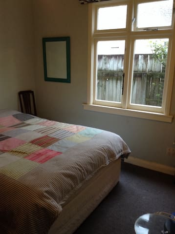 Comfy room in lovely Petone home.