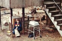 Kara as a little girl in front of her treehouse built by her grandfather and father.
