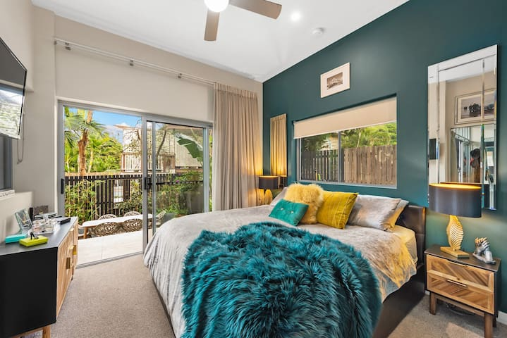 Luxe master bedroom with King Bed, Smart TV, air-conditioning, ceiling fan, walk-in robe, ensuite and direct courtyard access