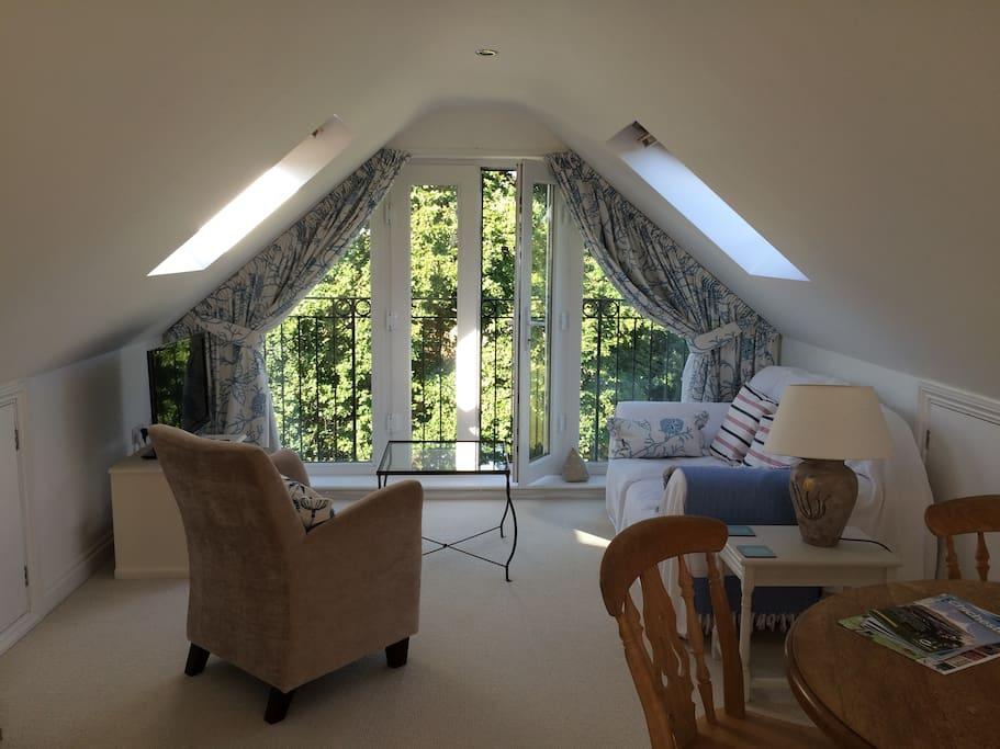 Loft Suite living area with views of garden