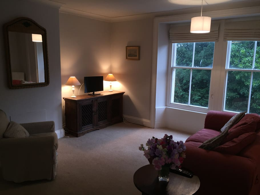 Large first floor sitting room with dining table and chairs