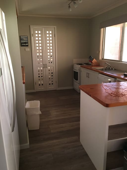 Kitchen (pantry behind lattice doors)