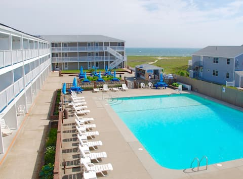 Seasonal outdoor pool with partial view of Cape Cod Bay – pool towels supplied
