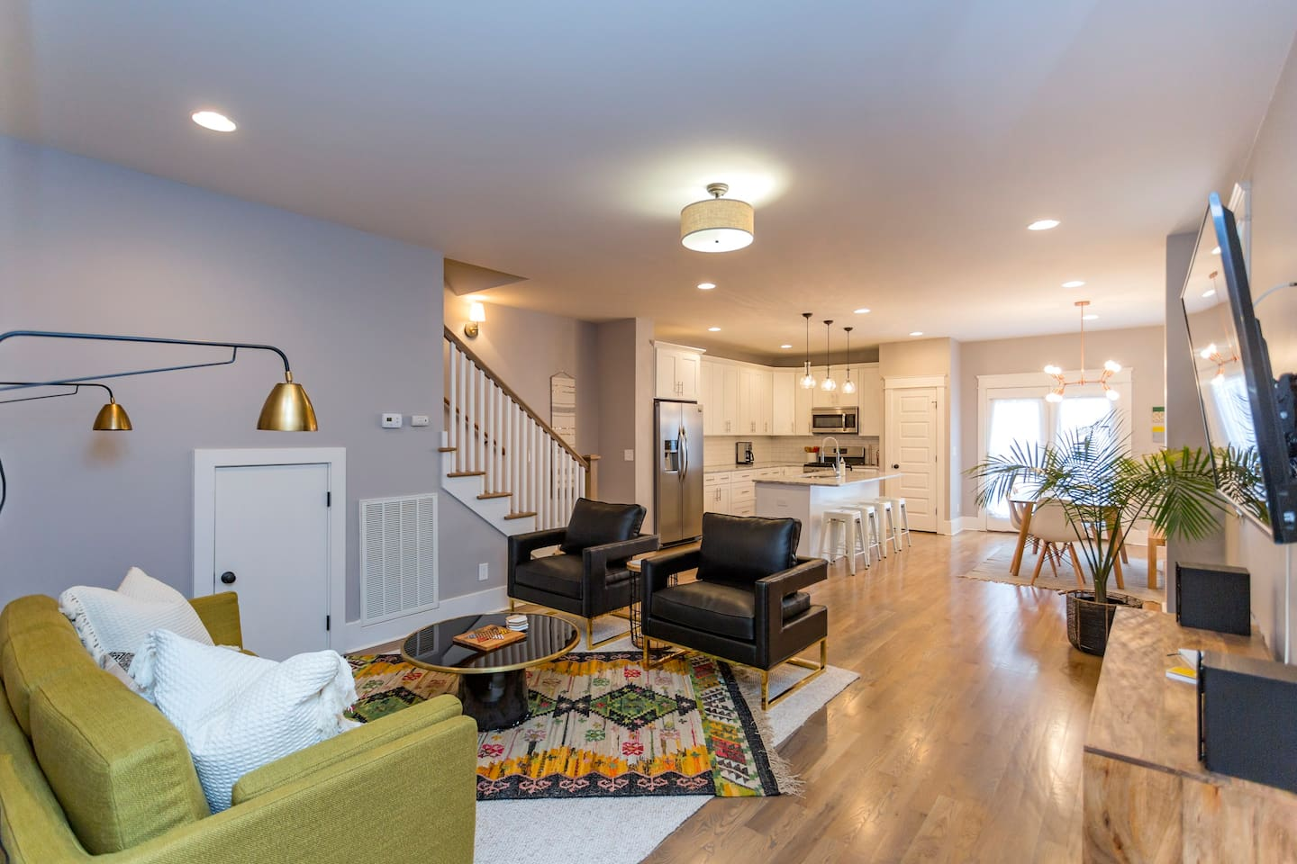 Downstairs layout with 4K full cable smart TV, living room, open kitchen and dining room!