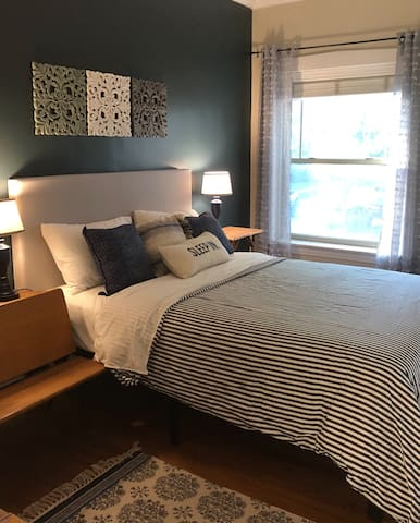 Master/queen bed with a view  One queen bed Soft linens, overhead ceiling fan, soft lighting, small dresser,  good size closet with hangers