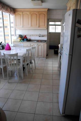 Bright kitchen with views