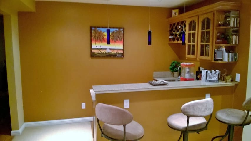 Relax in the home theater w/ a wet bar!