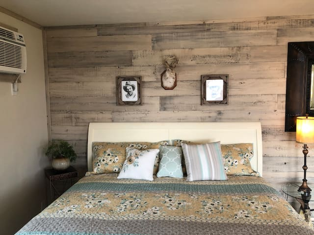 King size bed with view of the river