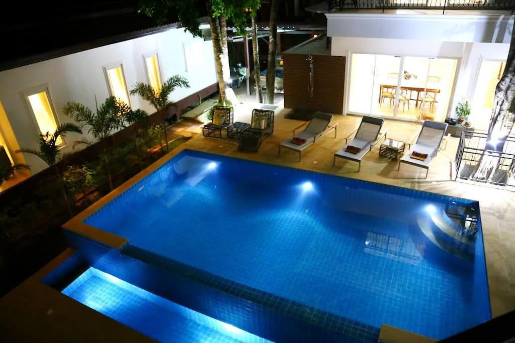 private pool lit up for night time swimming