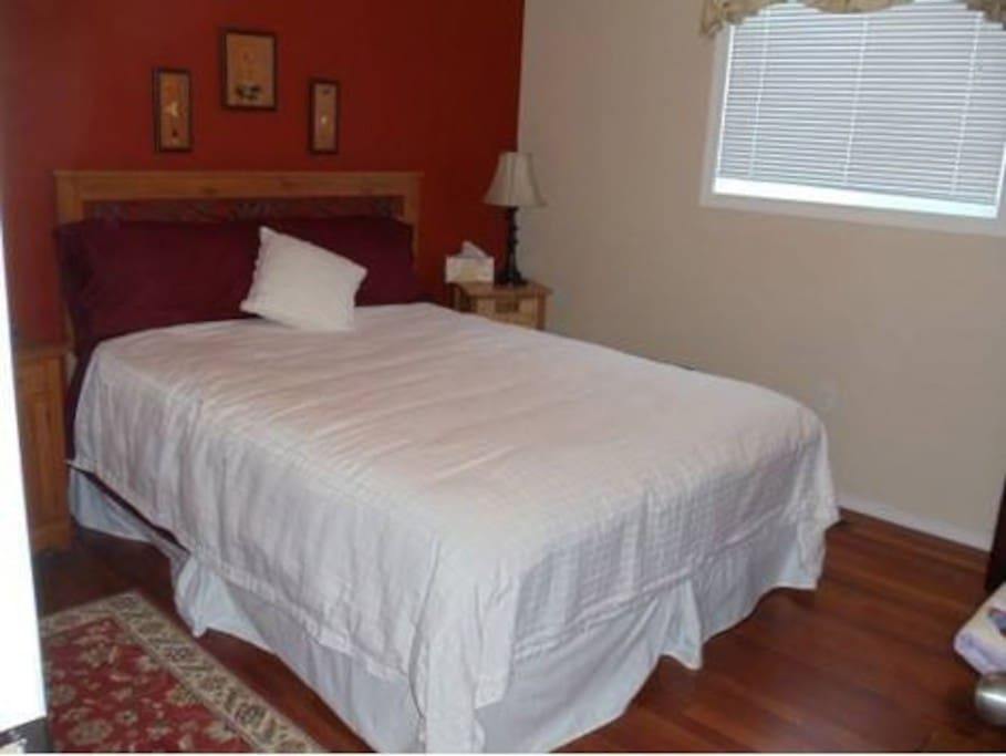 Prairie Rose Room with Queen bed and shared bathroom.