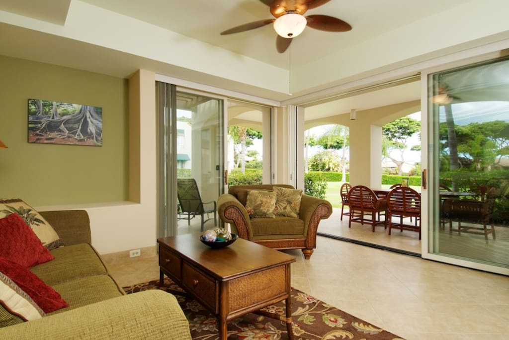 Open living room flows to large tiled lanai.