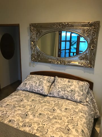 Second master bedroom with queen bed