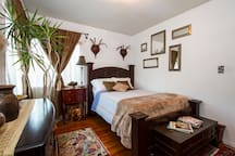 Your bedroom.  There is an electric portable heater and a cooling fan available to use. The bedroom faces the backyard and it has two sliding windows.