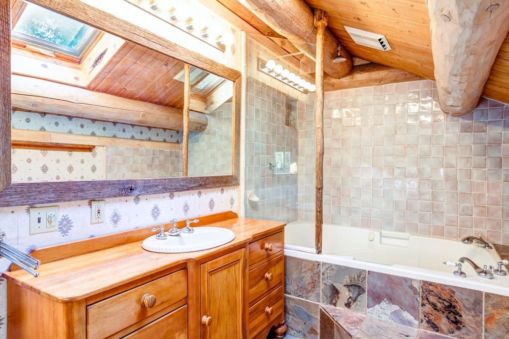 Master bath with shower and a large tub with jets.
