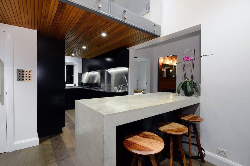 Dining & Kitchen area complete with solid polished concrete table