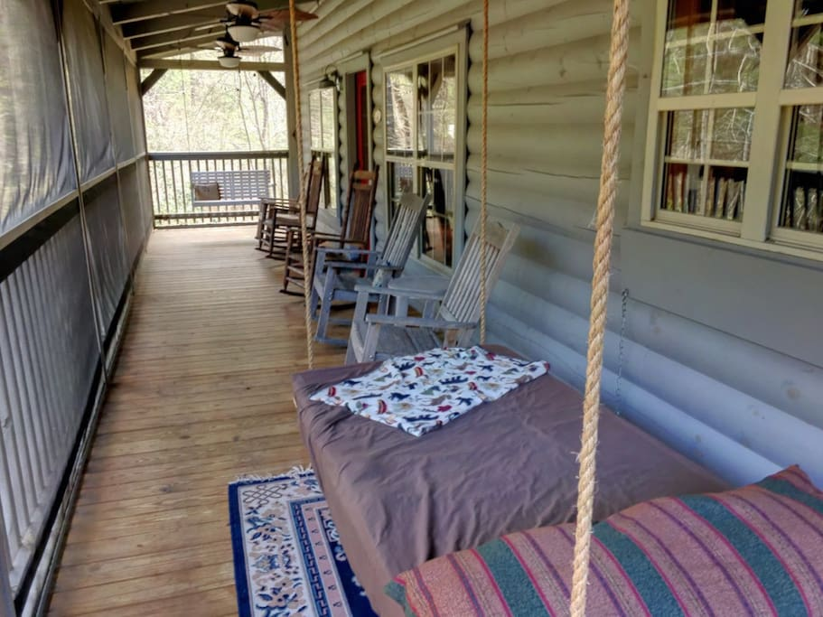 Grab a rocker on the screen porch...or take a nap on the swinging bed.