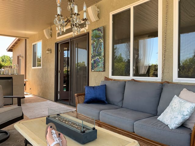Step out of the sliding glass doors are you'll steps into the outdoor tranquil oasis.