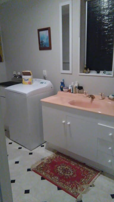 this is the bathroom with wash machine in it