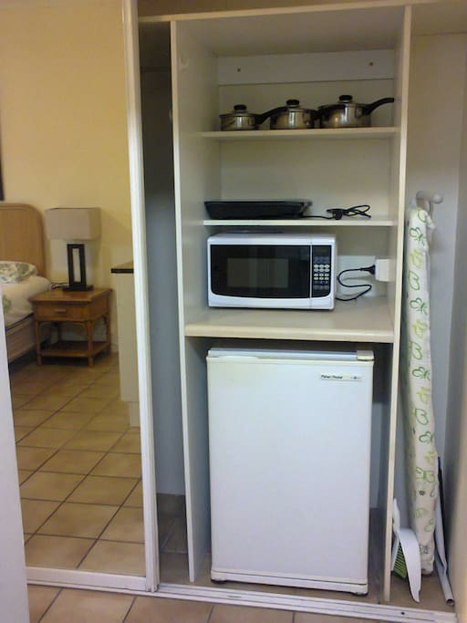 Microwave, Bar Fridge, Ironing Board. Induction Cooker