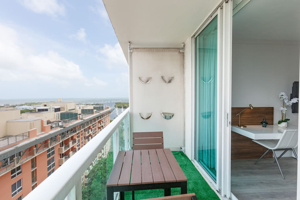 Seating area on balcony w/ bay view